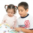 Brother and sister reading books on the floor — Stock Photo #10468978