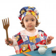 Little girl cooking dressed as a chef — Stock Photo #10469141