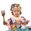 Stock Photo: Little girl cooking dressed as a chef
