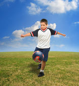 Kid playing soccer outside — Stock Photo