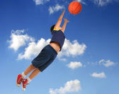 Boy playing basketball jumping and flying — Стоковое фото