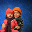 Brother and sister having fun in winter — Stock Photo #10470478