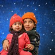 Stock Photo: Brother and sister having fun in winter