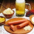 Stock Photo: Sausages with mustard and beer
