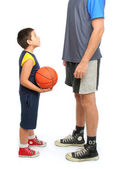 Little boy asking big man to play basketball — Stock Photo