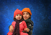 Brother and sister having fun in winter — Stock Photo