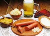 Sausages with mustard and beer — Stock Photo