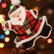 Santa with gift box over a pine cone — Stockfoto