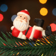 Santa resting over a christmas branch tree — Foto de Stock