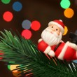 Santa resting over a christmas branch tree — Stockfoto