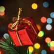 Gift box over a christmas branch tree — Stock Photo