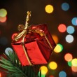 Gift box over a christmas branch tree — ストック写真
