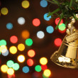Christmas bell hanging on a branch tree — Stock Photo #10499372