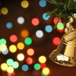 Christmas bell hanging on a branch tree — Stock fotografie