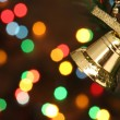 Christmas bell hanging on a branch tree — Stock Photo #10499440