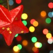 Christmas star on a tree branch — Stockfoto