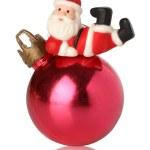 Santa resting over a christmas ball — Stock Photo #10499473