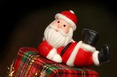Santa resting over a gift box — Stock Photo