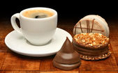Cup of coffee and sweet chocolates — Stock Photo