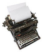 Old typewriter with a blank paper — Stock Photo