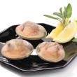 Three clams with lemon over white — Stock Photo