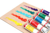 Five paint tubes over a pallete — Stock Photo