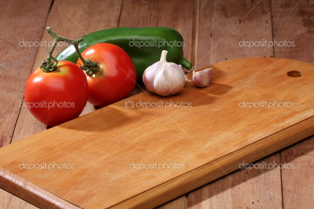 Cutting board with some vegetables  Stock Photo #10613471