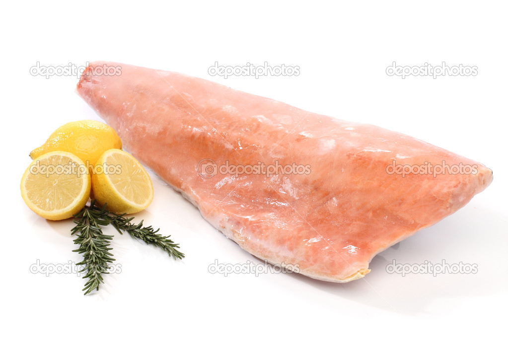 Frozen salmon fish fillet isolated on white — Stock Photo #10613615