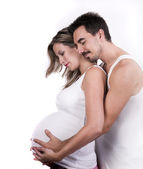 Young parents, pregnant mother and father together — Stock Photo