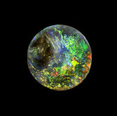 Round shape opal gem stone, like planet Earth — Stock Photo
