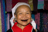 Lahu old woman with black teeth because of chewing herbs. — Stock Photo