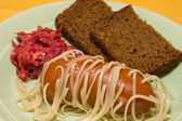 Pasta pierced sausage — Stock Photo