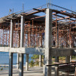 Scaffolding around new building — Stock Photo