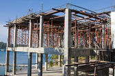 Scaffolding around new building — Stock Photo
