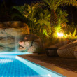 Foto Stock: Luxury resort with pool at night view