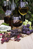 Wine and brandy, cheese and chocolate — Stock Photo