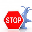 Little blue monster with stop sign — Stock Photo