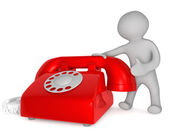 Small 3d human and red telephone — Stock Photo