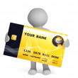 3d human figure holding yellow credit card — Stock Photo