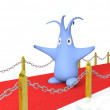Cute blue monster on red carpet — Stock Photo #10618861