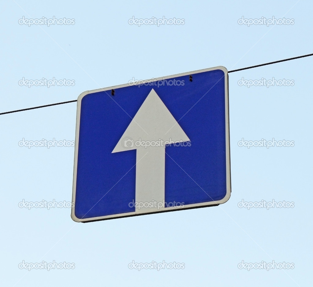 A road sign one-way traffic above the road — Stock Photo #10413872