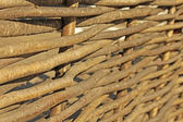 A woven fence made of many branches — Stock Photo