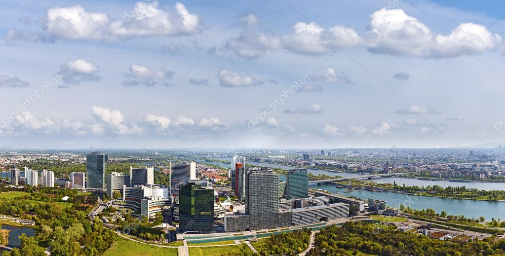 Very clear and detailed panorama of the amazing Skyline of Donau City Vienna with the famous UNO City at the left the Danube at the right and the Donaupark in front.  Stock Photo #10304418