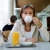 Enjoying a cup of coffee — Stock Photo