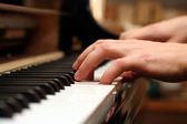 Hands of a piano playing guy — Stock Photo