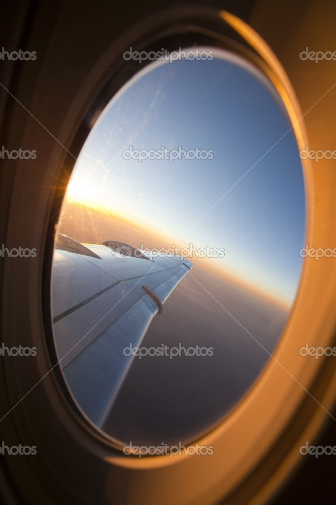 Looking through airplane window at sunset — Stock Photo #10404882