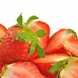 Intact and cut red strawberries — Stock Photo #10236429