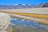 Reflection barren mountainsin lake — Stock Photo