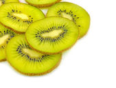 Sliced kiwi fruit over white — Stock Photo