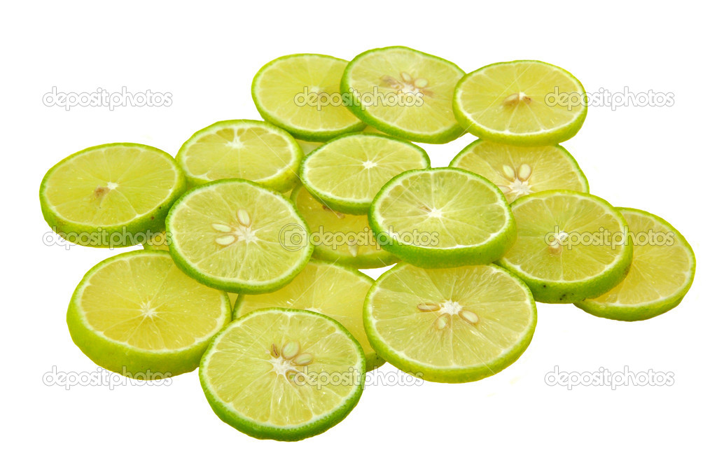 Close up of slices of lemon piled on white background — Stock Photo #10342363